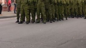 Soldier formation. Dressed in camouflage clothing waiting for a command on a public parade stock video footage