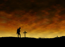 Soldier in front of Cross from First World War Stock Images