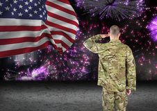 soldier in front of fireworks with usa flag Stock Image