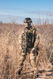 Soldier in full NATO uniform. Airsoft player in NATO soldier uniform with rifle training in fields royalty free stock photos