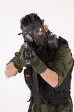 Soldier in a Gas mask. Soldier in Gas Mask, pointing a rifle and isolated against a white background stock photo