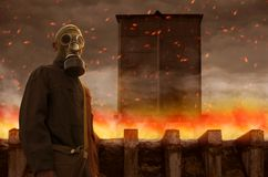 Soldier in gas mask. On on fire background royalty free stock photography