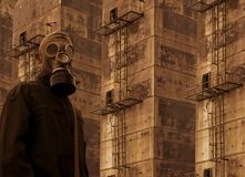 Soldier in gas mask. On on fire background royalty free stock photos