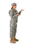 Soldier: Gesturing to Side. Series with a female as a solidier in an United States Army uniform.  Numerous props convey a variety of concepts.  Isolated on a Royalty Free Stock Images