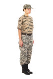 Soldier: girl in the military uniform. Young girl-soldier in the camouflage military uniform and hat, standing by the front Royalty Free Stock Photos