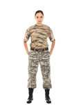 Soldier: girl in the military uniform. Young girl-soldier in the camouflage military uniform standing by the front Stock Photos