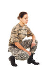 Soldier: girl in the military uniform. Young girl-soldier in the camouflage military uniform turned to side Stock Photo