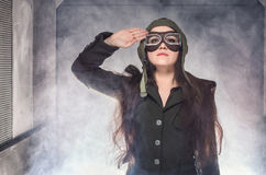 Soldier girl in retro elevator. Woman soldier in World War II uniform. Standing in smoke in old elevator royalty free stock photography