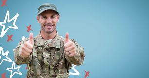 Soldier giving two thumbs up against blue background with red and white hand drawn star pattern Stock Image