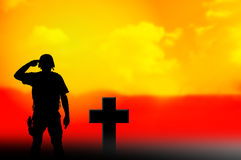 Soldier and grave cross silhouettes. As veteran and army hero concept Royalty Free Stock Photography