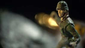 The soldier in green uniform. A toy soldier in green uniform stands in the snow stock video
