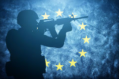 Soldier on grunge European Union flag. Army, military Royalty Free Stock Photography
