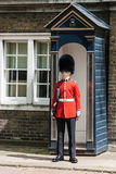 Soldier On Guard. A British soldier on guard duty outside St. James' Palace in London Stock Photo