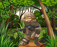 Soldier with gun in the jungle Stock Image