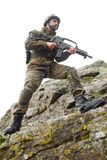 Soldier with a gun moving Stock Photography