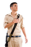 Soldier with gun putting hand on his chest royalty free stock photo