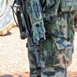 Soldier with a gun ready for combat Stock Photo