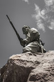 Soldier with gun. On the rock of the Marine monument, remembering the German soldiers killed during the Herero rebellion 1904-1905, Swakopmund, Namibia, Africa stock images