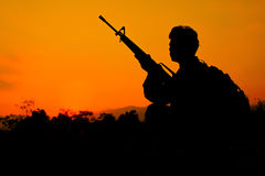 Soldier and gun in silhouette shot Royalty Free Stock Image