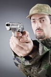 Soldier with gun in studio Stock Photo