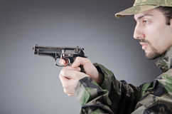 Soldier with gun in studio Stock Photos