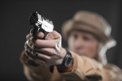 Soldier with a gun takes aim on dark background Stock Photography