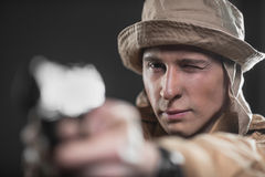 Soldier with a gun takes aim on dark background Royalty Free Stock Photos