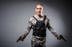 Soldier with guns Stock Images