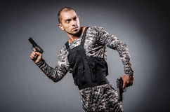 Soldier with guns Royalty Free Stock Image