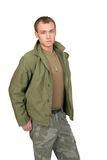 Soldier guy. One fit attractive soldier in green and brown with dogtags and jacket half length portrait over white Stock Images
