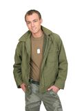 Soldier guy. One fit attractive soldier in green and brown with dogtags and jacket half length portrait over white stock image
