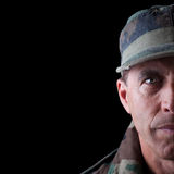 Soldier Half Face. Army veteran portrait isolated on black background stock photo