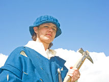 Soldier with hammer type weapon. Royalty Free Stock Photography