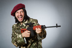 The soldier with handgun against gray Royalty Free Stock Image
