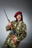 The soldier with handgun against gray Royalty Free Stock Photography