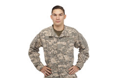 Soldier with hands on hips. Portrait of soldier with hands on hips against white background royalty free stock photos