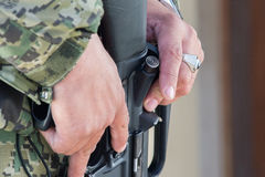 Soldier hands holding machine gun Royalty Free Stock Images