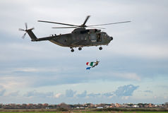 Soldier hanging flag from an italian helicopter Stock Images