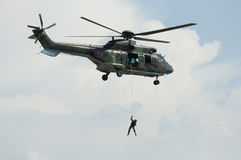 Soldier hanging from a helicopter Royalty Free Stock Photo