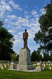 Soldier in heaven - statue in cemetery with memorial veterans independence day flags stock image