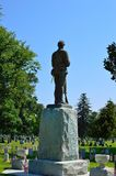 Soldier in heaven - statue in cemetery blue sky with memorial veterans independence day flags royalty free stock photography