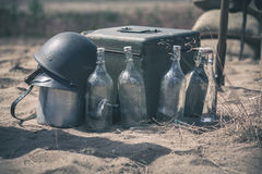 Soldier helmet with ammo box and empty bottles Royalty Free Stock Photography