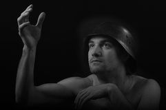 Soldier. With helmet looking towards the light.  Artistic black and white portrait Royalty Free Stock Photo