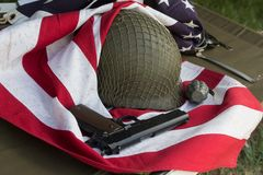 Soldier helmet, pistolt and grenade from the Second World War and the flag of the USA. Patriotism stock photos