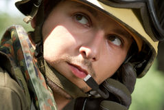 Soldier in helmet talking on a headset Royalty Free Stock Photo