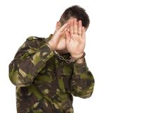 Soldier hiding his face Stock Photo