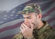 Soldier hiding his mouth with his hands in front of american flag. Digital composite of Soldier hiding his mouth with his hands in front of american flag Stock Photos