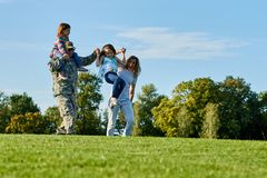 Soldier and his family having fun outdoors. stock image
