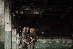 Soldier and his wife at the battlefield stock photography