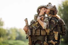 Soldier and his wife at the battlefield stock photos
